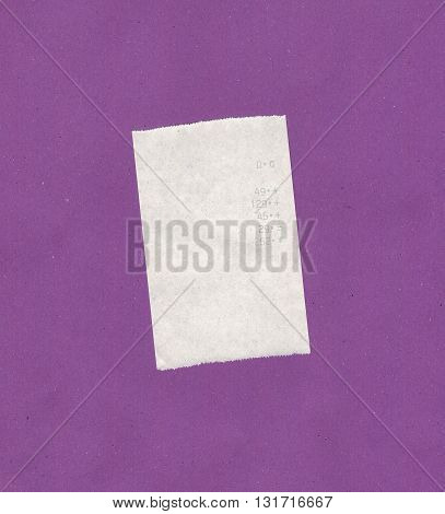 Bill or receipt isolated over violet background