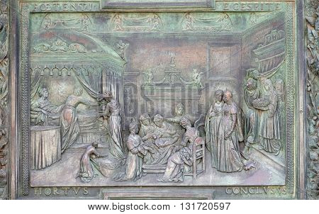 PISA, ITALY - JUNE 06, 2015: Nativity of the Virgin, panel of the central door of the Cathedral St. Mary of the Assumption, artwork from the school of Giambologna in Pisa, Italy on June 06, 2015