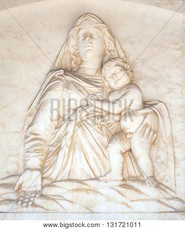 PISA, ITALY - JUNE 06, 2015: Madonna with the Child, by Andrea Gurdi lunette over the portal of Cathedral in Pisa, Italy. Unesco World Heritage Site, on June 06, 2015