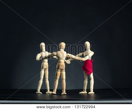Family of wooden figures in circle