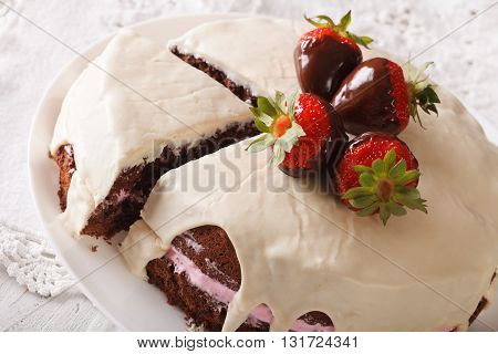 Chocolate Cake With White Icing And Strawberries Close-up. Horizontal