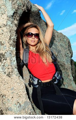Young woman tourist posing at the mountains.