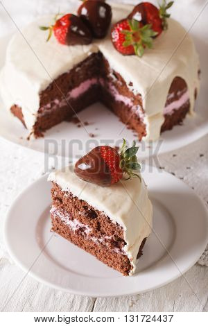 Cut A Piece Of Cake With Dark And White Chocolate And Strawberry. Vertical