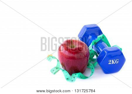 Red apple dumbbelle and measuring tape on a white background