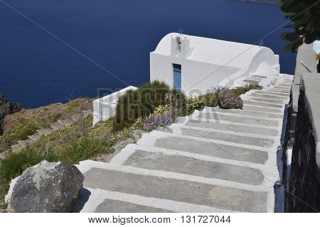 Traditional Blue And White Chapel At Imerovigli