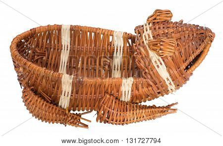 Empty wicker basket in the form of a frog. Isolated on white the background. Side view.