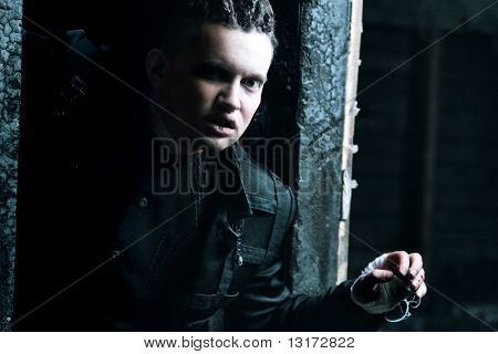 Shot of a scary man with bloody hands,  gothic style. Halloween, horror.