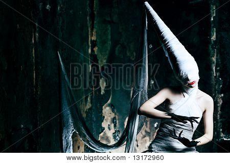 Shot of a twilight girl in white dress. Halloween, horror.