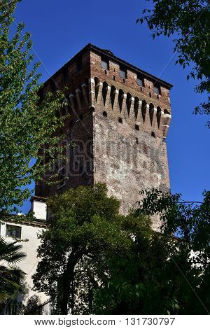 Porta Castello Tower. An imposing medieval tower over Vicenza main gate, the last surviving part of an ancient castle, seen from Giardini Salvi public park