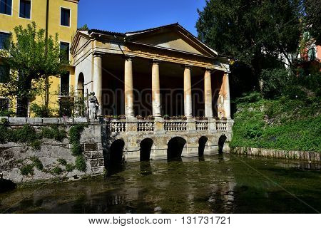 VICENZA, ITALY - APRIL 14: Renaissance Loggia Valmarana built in 1591 and Roggia Seriola ancient moat from Giardini Salvi public park in the center of Vicenza APRIL 14, 2016 in Vicenza, Italy