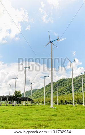 Group wind turbine generator of clean energy under the blue sky in Thailand