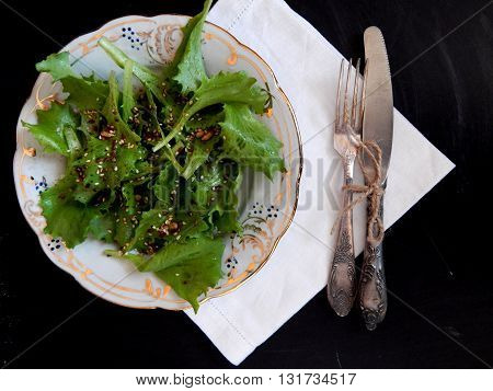 Fresh lettuce salad with sesame flax and sunflower
