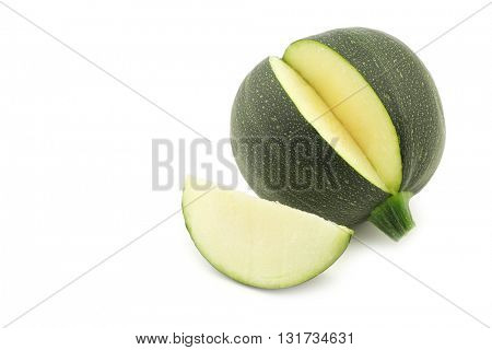 fresh round zucchini and a cut piece on a white background