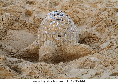 sand castle on the beach in the sunset