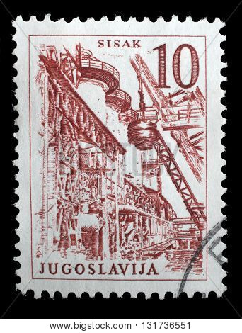 ZAGREB, CROATIA - JUNE 14: Stamp printed in Yugoslavia shows a Steel Plant, Sisak, with the same inscription, from series