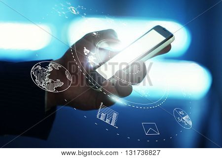 Man using mobile phone against high tech background