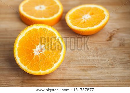 Sliced juicy orange bright orange on a wooden board