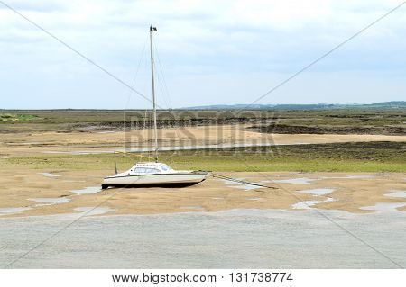 Sailing boat during low tide in Wells-next-the-sea