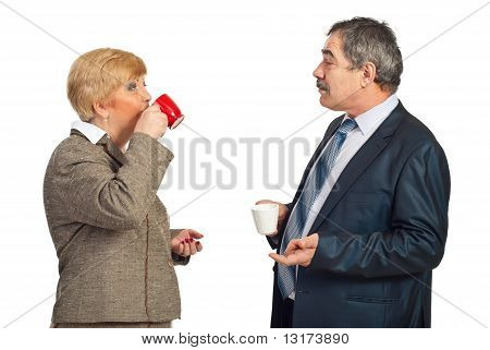 Mature Business People Drinking Coffee