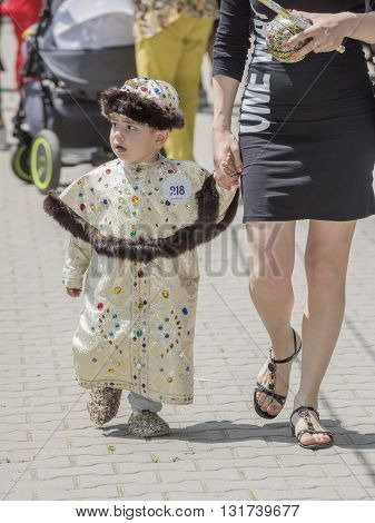 Rostov-on-Don Russia- May 222016: Boy in a beautiful dress at the carnival
