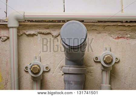 a mount new plastic pipe on wall