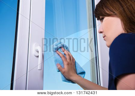 Woman Cleaning Window With Special Rag