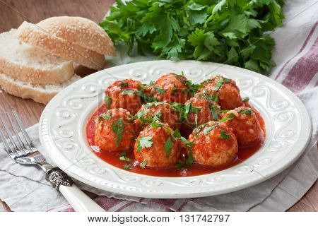 Delicious homemade chicken or turkey meatballs with rice vegetable and tomato sauce