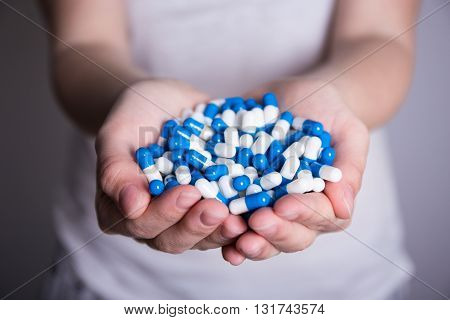 Close Up Of Pills In Female Hands