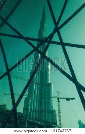 DUBAI, UAE - MAY 11, 2016:  view on Burj Khalifa tower in Dubai through window in metro link