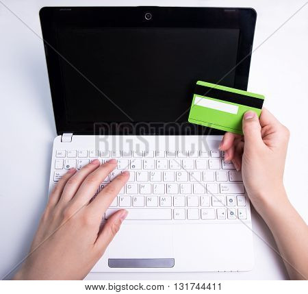 Online Shopping - Laptop With Blank Screen And Hands Holding Credit Card