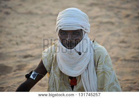 TIMBUKTU, MALI, 02-SEPTEMBER-2011.  Tuareg smoking his pipe in a camp near Timbuktu