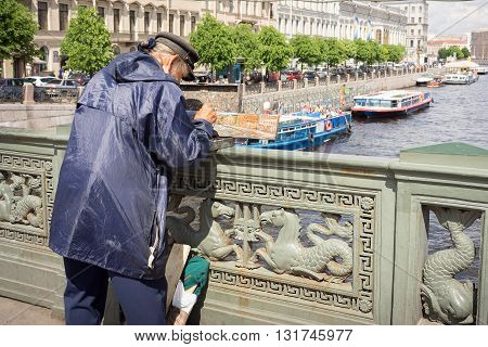 St Petersburg Russia - May 26 2016: Unidentified painter paints on Nevskom prospectus the boats in Fontanka river on Anichkov bridge. Saint-Petersburg has also been nicknamed
