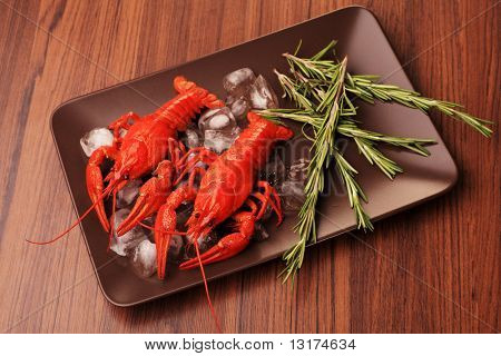 A dish with boiled crawfish with rosemary.