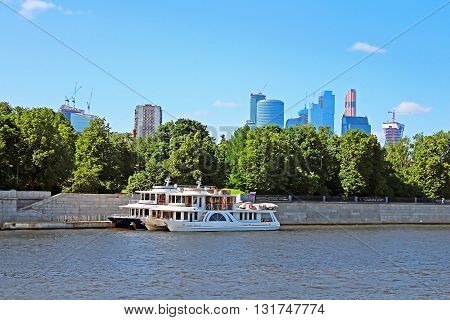 View on new Moscow City buildings and pleasure boats in summer, Russia