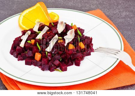 Beetroot Salad with Herring on Plate. Studio Photo