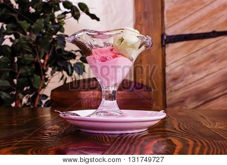 beautiful vase with ice cream on wooden table
