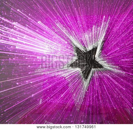 ABSTRACT SPEED EFFECT BLACK AND SILVER STAR ON PURPLE BACKGROUND