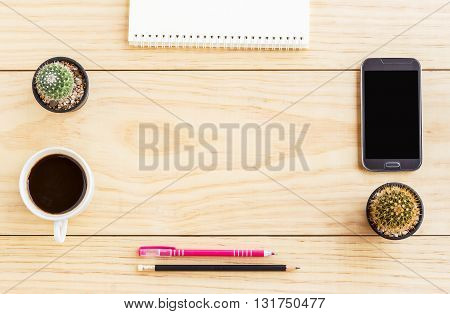 Flat lay office desk with notebooks smart phonepen and a cup of coffee. Top view with copy space.
