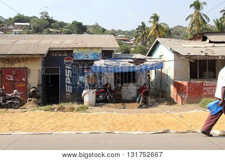 MWANZA TANZANIA - JUNE 11: local stores with maize put out in the sun to dry along the road on June 11 2013 in Mwanza