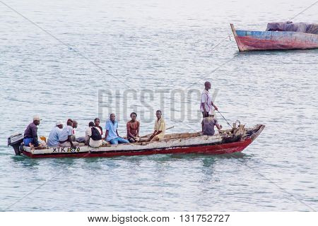 ZANZIBAR TANZANIA - JUNE 16: people sailing on a typical water taxi on June 16 2013 in Zanzibar. This cheap transportation is mainly used by the local population