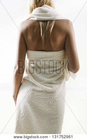 BLONDE WOMAN'S BODY , WEARING BODY AND HAIR BATH TOWELS , ISOLATED ON WHITE BACKGROUND