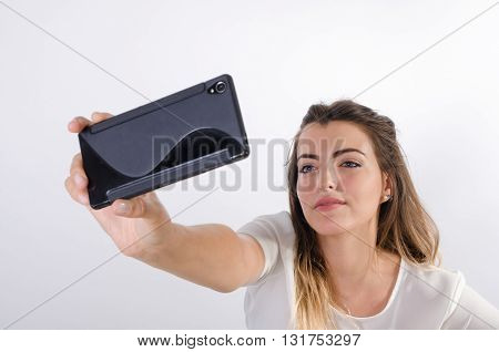Young Pretty Girl Making A Selfie