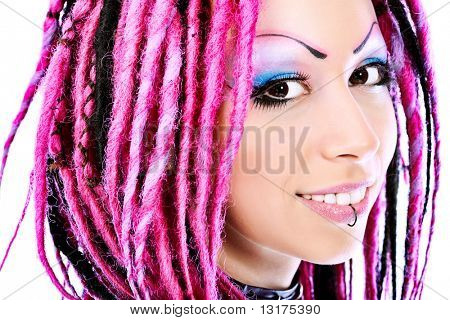 Beautiful young woman with pink dreadlocks. Isolated over white background.