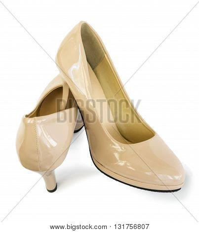 Pair of beautiful shoes of beige color on white background