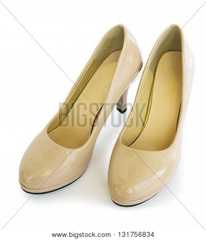 Pair female shoes of beige color on white background