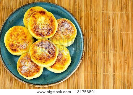 Sweet Cheese Fritters on Plate. Studio Photo