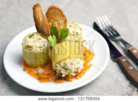Vegetable marrow zucchini  stuffed with turkey meat, diet dish, a hearty meal. close-up on a plate, croutons