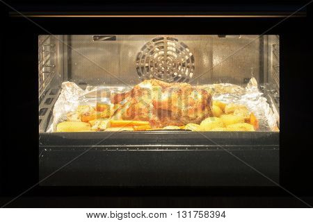Roast chicken in the oven, lunch time