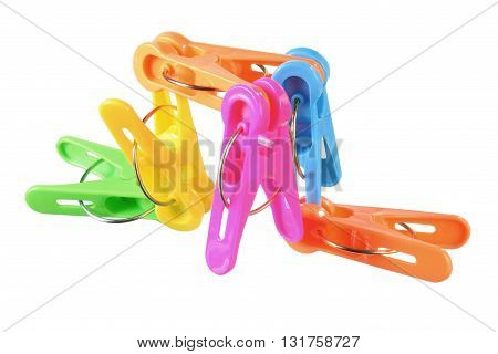 Plastic Clothes Pegs on Isolated White Background