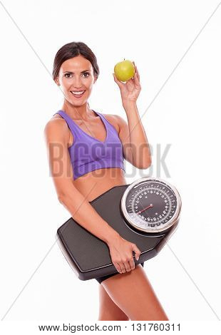 Healthy Brunette With Apple And Scale